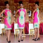 You gotta love this high neck knee length ankara dress